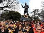 Football fans line up to watch the AFL Grand Final parade on Friday. Picture: AAP Image/Joe Castro