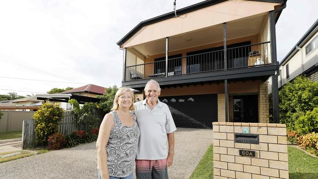 SAY CHEESE: Hannah and Barry Stevens posing at their home in Scarborough which they're selling, it has a 3.4kw solar system, herb garden and water tank. IMAGE: Josh Woning