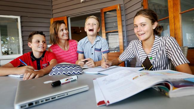 Monique Harley, with 11-year-old Jack, 9-year-old Nicholas and 14-year-old daughter Meg, says it can be difficult to help her kids with homework as teaching methods have changed. Pic: Tara Croser.