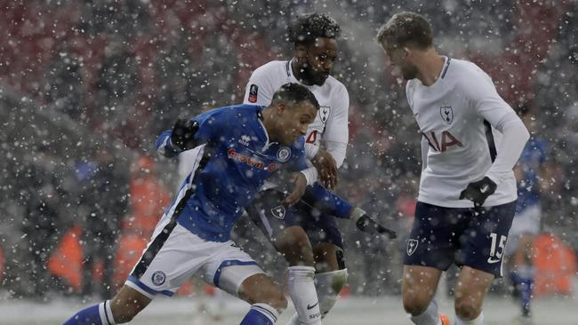 Rochdale's Joe Thompson, falls under pressure from Tottenham Hotspur's Mousa Dembele and Tottenham Hotspur's Eric Dier