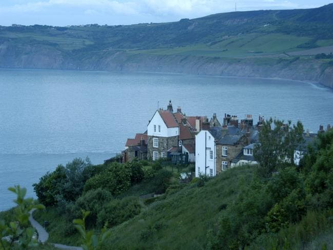 Homes perched on the edge of a cliff.