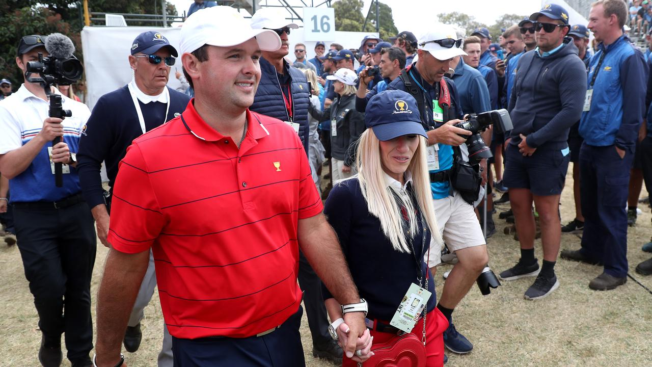 Patrick Reed and his wife Justine after the win. (Photo by Rob Carr/Getty Images)