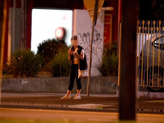 Another young sex worker waits on a St Kilda street before a customer picks her up and takes her away.