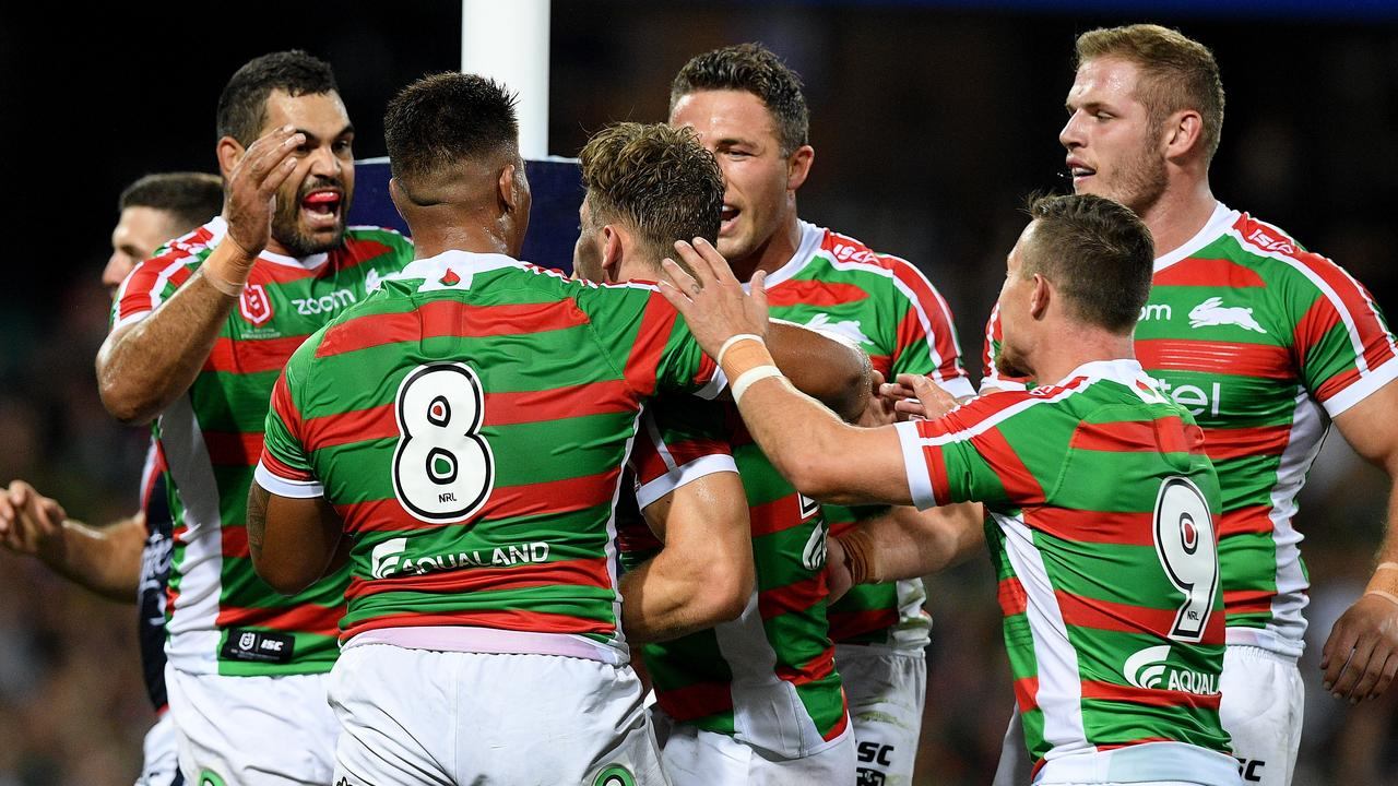 Rabbitohs lock Cameron Murray (centre) celebrates with teammates after scoring a try off the boot of Adam Reynolds.