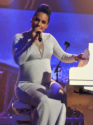 A pregnant Alicia Keys performs during the MTV EMA's 2014.