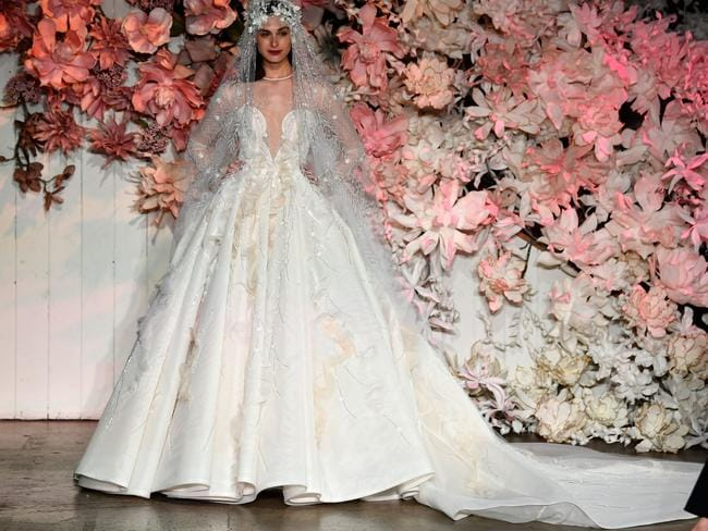 The stunning bridal gown took more than eight weeks to make, and cost $100,000 Picture: Stefan Gosatti/Getty Images.