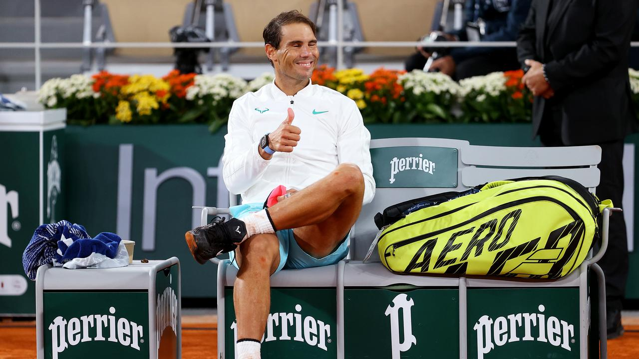 Rafael Nadal takes a moment to soak in his 13th French Open win.