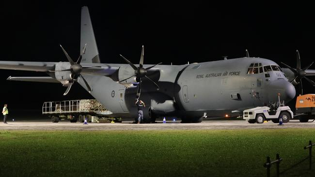 Australian military personnel offload supplies to Christmas Island, where Australians have been quarantined after being evacuated from Wuhan, China. Picture: Richard Wainwright/AAP