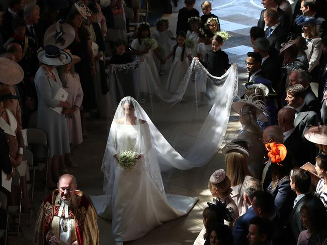 Meghan walked down the aisle solo to begin with. Picture: Brian Lawless/Getty Images