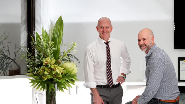 Brett Hunter, Managing Director of Raine & Horne Terrigal and Patrick Hill, CEO of Realm. Picture: Sue Graham.