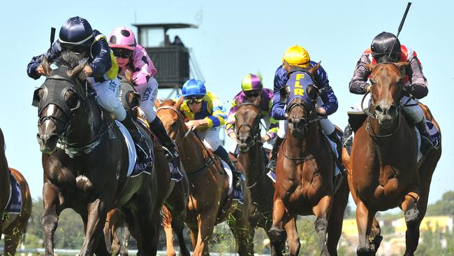 Bad Wolf (left) storms to victory at Flemington. Picture: AAP