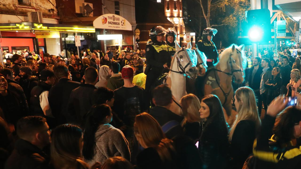 Mounted police watch over Tigers fans celebrating their team's victory on Swan Street. (AAP Image/David Crosling