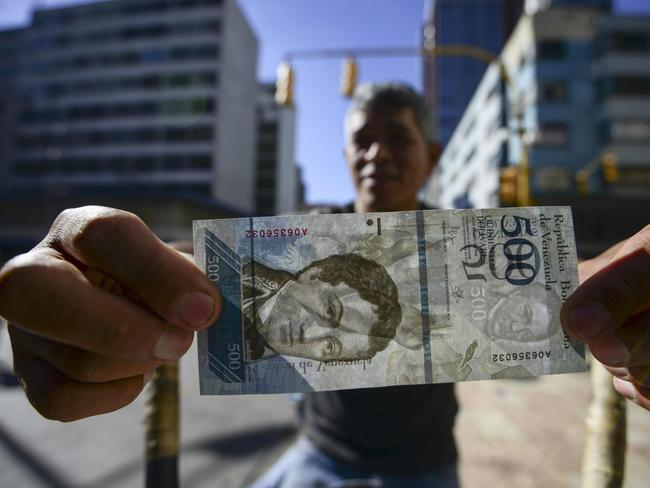Venezuela has the highest rate of inflation in the world. In December, it reached an all-time high of 800 per cent. Picture: AFP/Juan Barreto