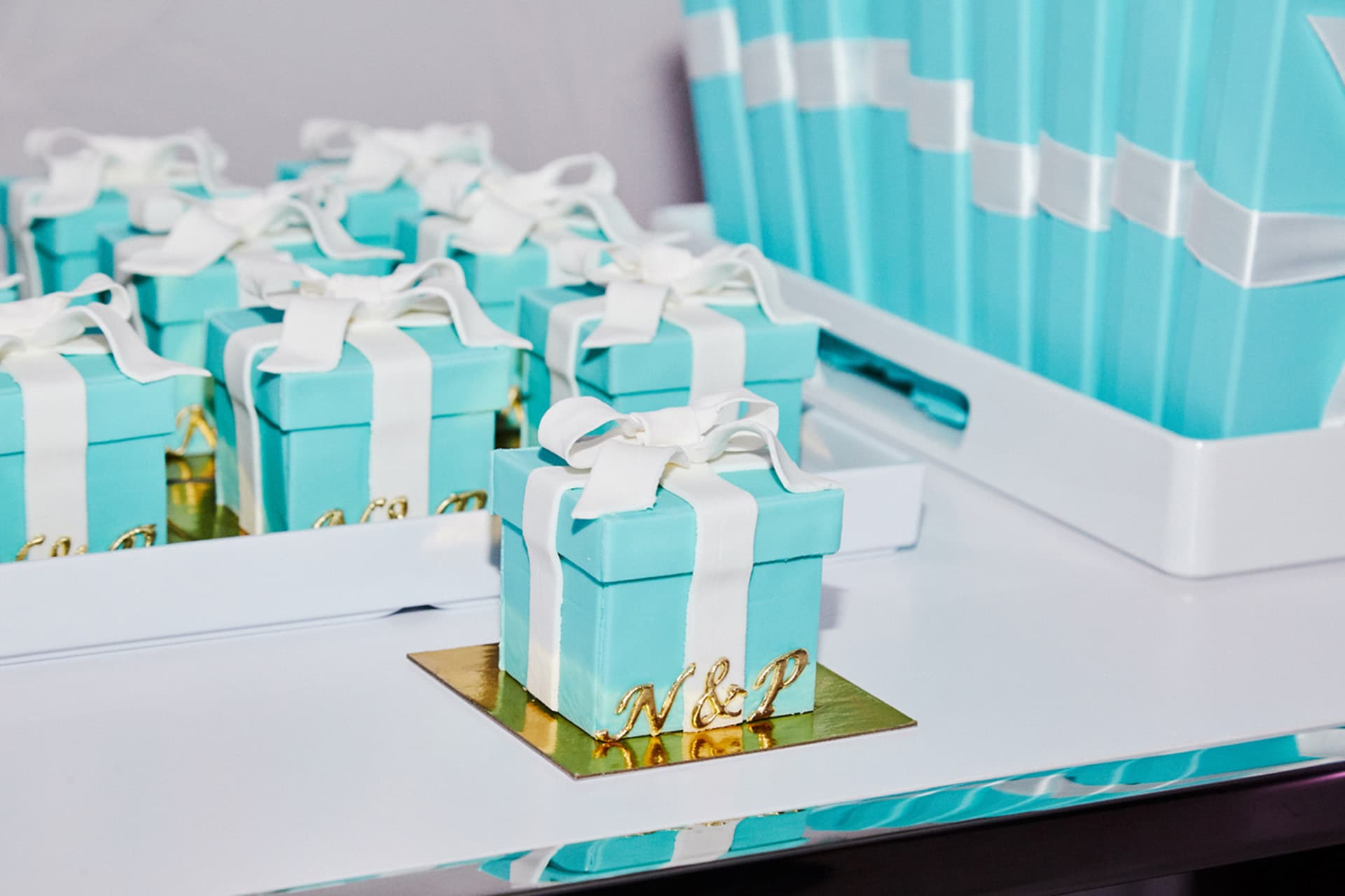 Guests took home Tiffany box-shaped cakes. Image credit: Andrew Day