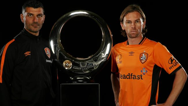 Brisbane Roar coach John Aloisi (left) with star recruit Brett Holman with the A-League trophy at the A-League season launch in Melbourne on Wednesday.