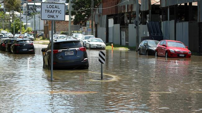 Northey Street in Windsor during local flooding from Enoggera Creek, sparked by a king tide, the supermoon and the effects of Cyclone Oma. Picture: AAP