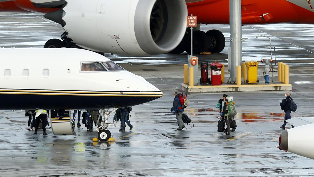 Passengers from New Zealand who arrived in Melbourne board a smaller jet for the trip across the Tasman. Picture: Getty