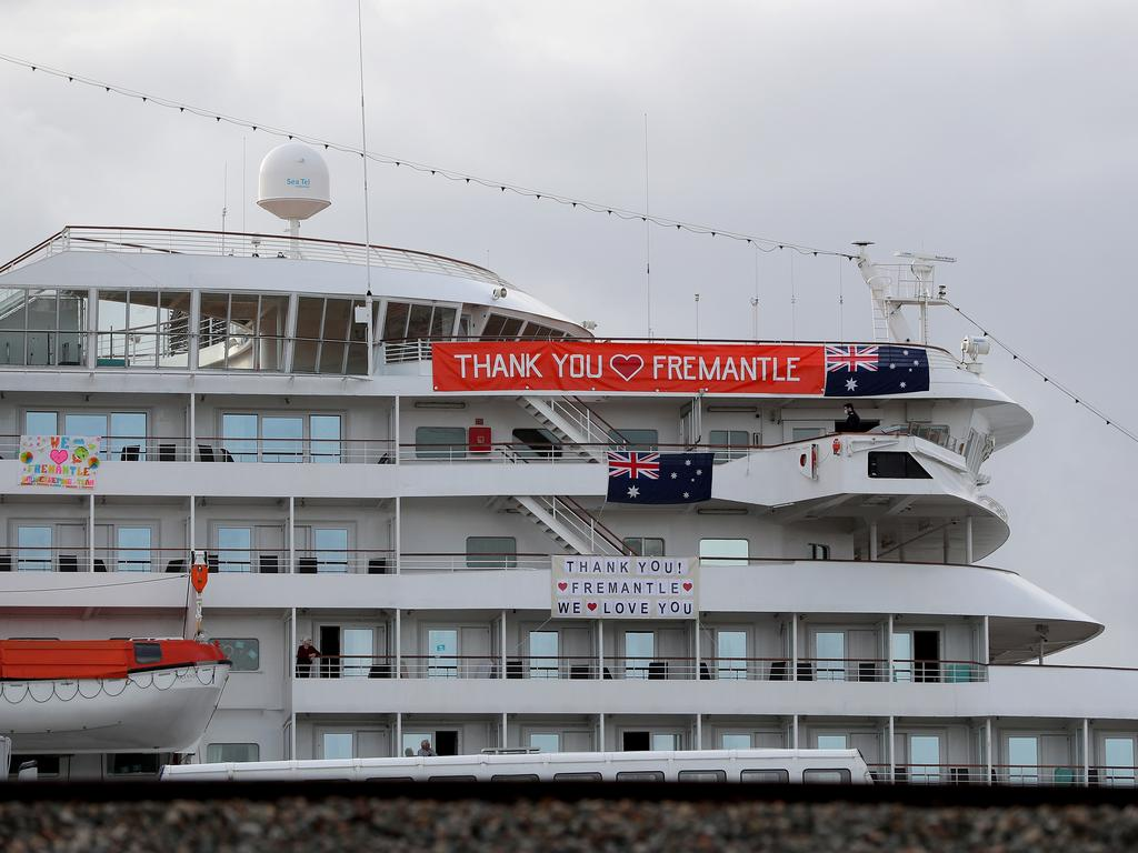 Banners are hung from the cruise ship MV Artania in Fremantle harbour in Fremantle.
