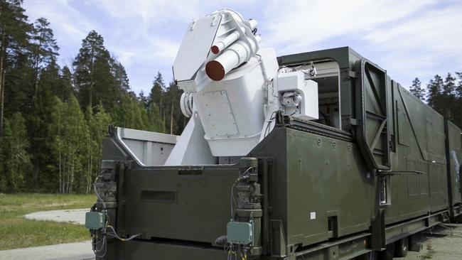 A Russian military truck with a laser weapon mounted on it is shown at an undisclosed location in Russia. Picture: RU-RTR Russian Television via AP