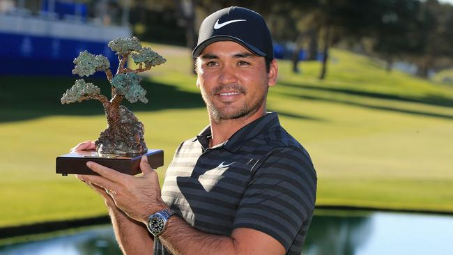 Jason Day with the Farmers Insurance Open trophy.