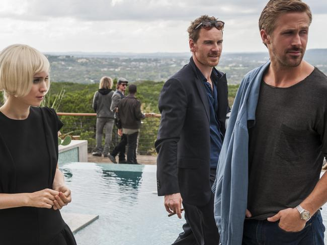 Rooney Mara, Fassbender and Ryan Gosling in a scene from the movie Song to Song.