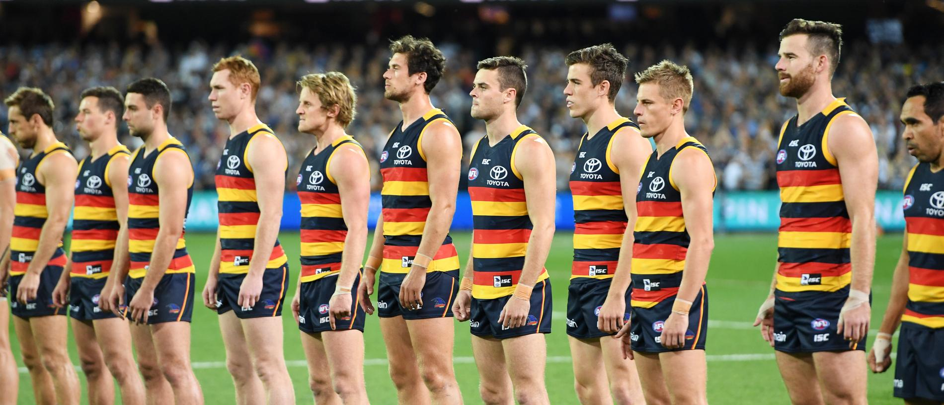 The Crows line up for the national anthem before the Adelaide Crows and Geelong Cats Men's AFL First Preliminary Final at the Adelaide Oval in Adelaide, Friday, September 22, 2017. (AAP Image/Tracey Nearmy) NO ARCHIVING, EDITORIAL USE ONLY