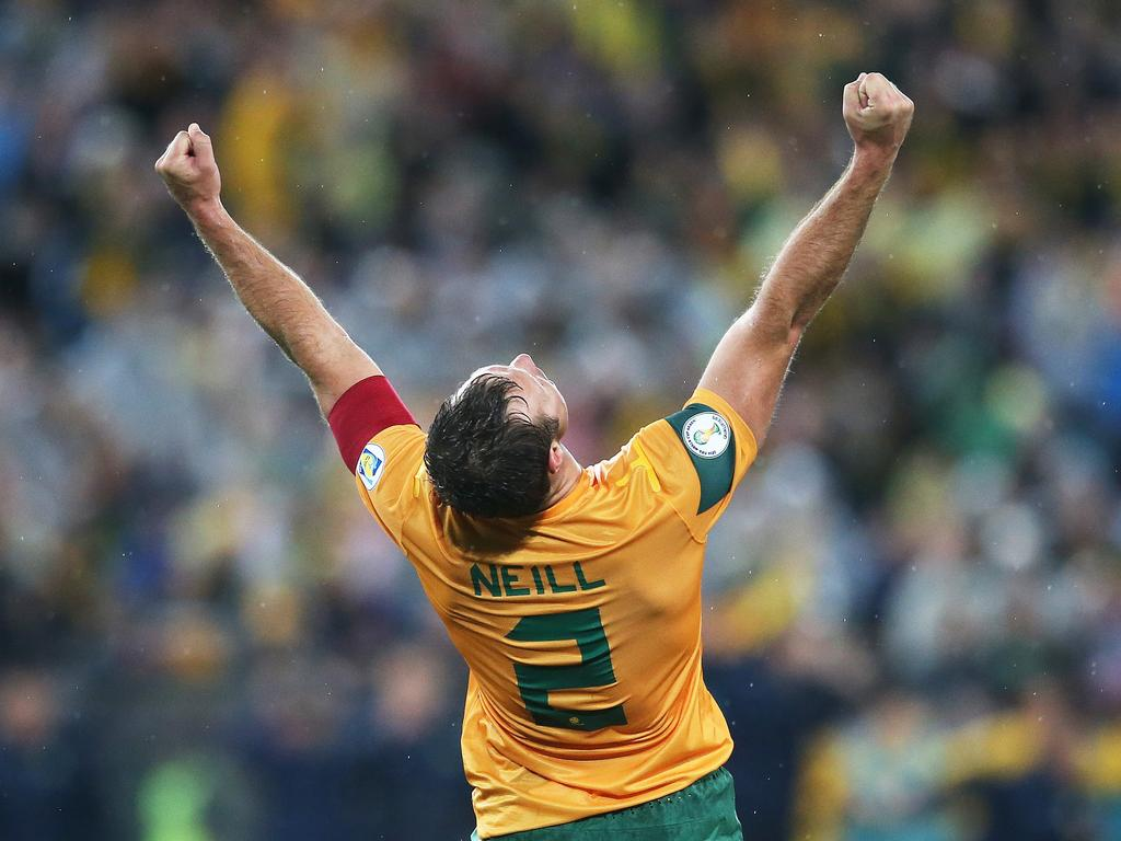Lucas Neill celebrates a World Cup qualifier victory over Iraq in Sydney, 2013.