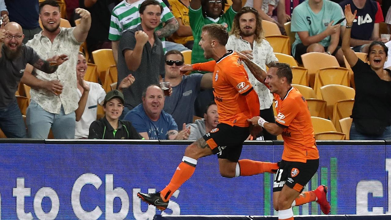 Adam Taggart of Roar celebrates a goal