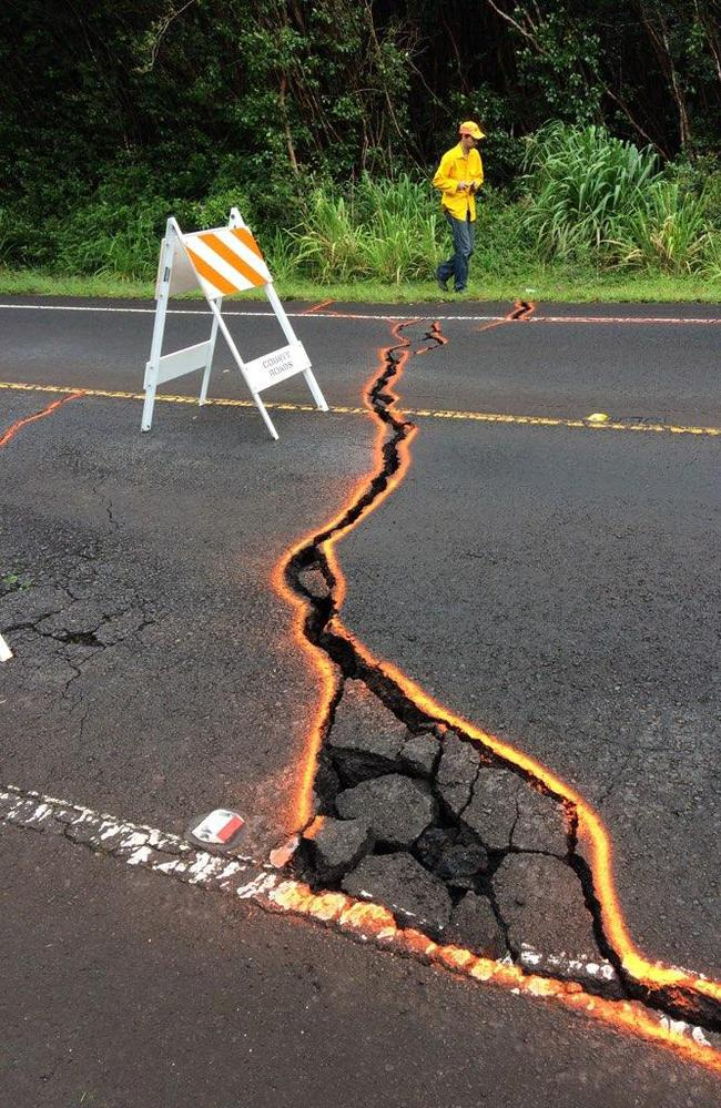 Cracks in Highway 130 outlined in orange on May 7, at Leilani Estates, Hawaii. Picture: AP