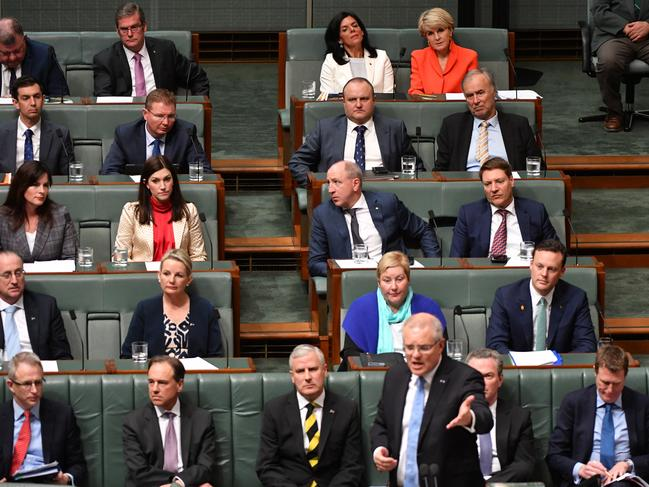 Spot the red. That's Ms Bishop in the back corner, in case you missed her. Picture: Mick Tsikas/AAP