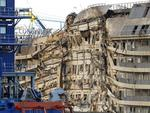 A view of the wreck of Italy's Costa Concordia cruise ship after emerging from water on September 17, 2013, near the harbour of Giglio Porto. Salvage operators in Italy lifted the Costa Concordia cruise ship upright from its watery grave off the island of Giglio in the biggest ever project of its kind. The ship's horn sounded for the first time since the January 13, 2012 tragedy, its sound mixing with applause and cheers in the port in a dramatic climax to the massive salvage operation. Local residents and survivors spoke of an eerie feeling as the ship rose, saying the sight reminded them of the tragedy that claimed 32 lives. AFP PHOTO / ANDREAS SOLARO
