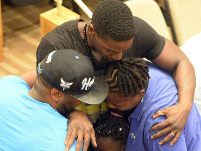 Family embraces Zianna after her speech. Picture: David Foster/AP
