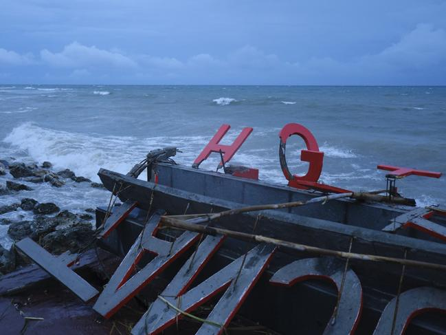 A hotel sign damaged lays shattered on the beach. Picture: Getty Images