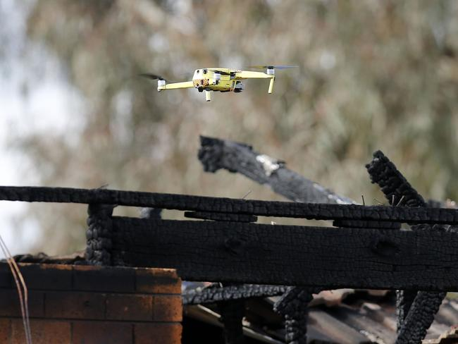 Fire and Rescue use a drone above the house. Picture: Darren Pateman/AAP