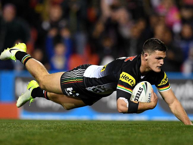 Nathan Cleary of the Panthers scores a try.