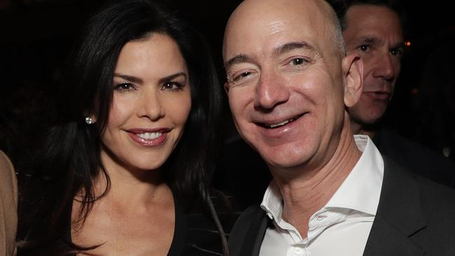 Jeff Bezos and Lauren Sanchez at a party together in 2016. Picture: Getty