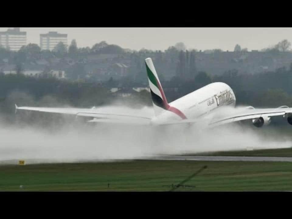 Landing Plane Kicks Up Massive Spray