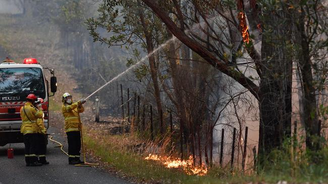 Firefighters backburning in the Mangrove area, northwest of Sydney. Picture: Saeed Khan/AFP