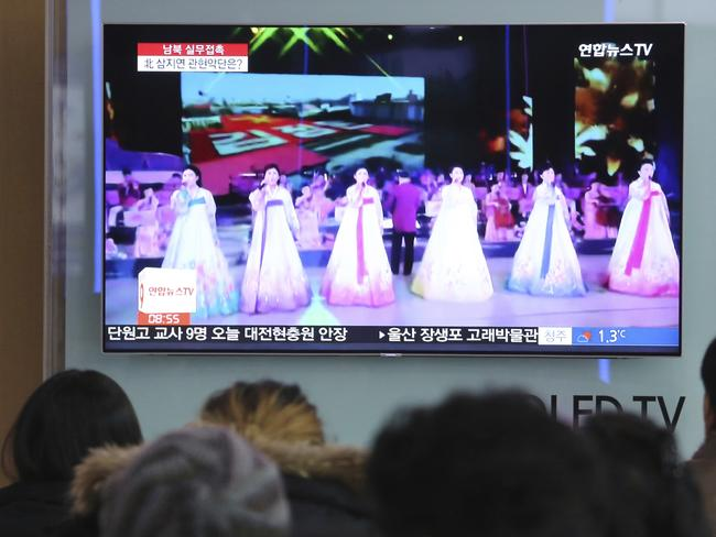 People watch a TV screen showing a file footage of North Korea's art troupe in Seoul, South Korea on Jan. 16, 2018. Picture: AFP