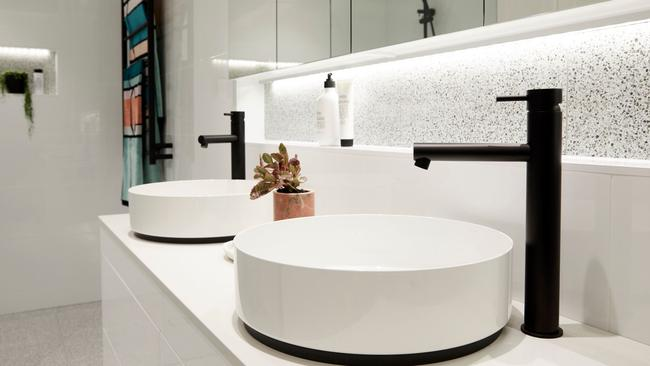 They went for an elegant look with circular basins and black taps. Source: The Block