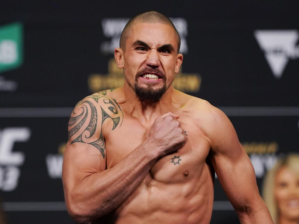 Robert Whittaker of Australia reacts after weighing in during the UFC 243 Weigh In Day at Marvel Stadium in Melbourne, Saturday, October 5, 2019. (AAP Image/Michael Dodge) NO ARCHIVING