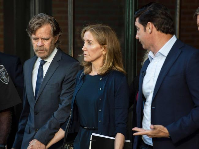 Felicity Huffman, escorted by her husband William H. Macy (L) and her brother Moore Huffman Jr. (R). Picture: Joseph Prezioso