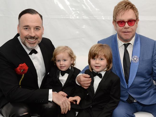 Family ... David Furnish, Elijah Furnish-John, Zachary Furnish-John, and Sir Elton John. Picture: Getty