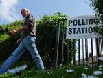 BROTTON, UNITED KINGDOM - JUNE 23: A man leaves the grounds of Brotton Church, location of one of the polling stations in the Redcar and Cleveland area, as voters head to the polls to cast their vote on the EU Referendum on June 23, 2016 in Brotton, United Kingdom. The United Kingdom has gone to the polls to decide whether or not the country wishes to remain within the European Union. After a hard fought campaign from both REMAIN and LEAVE the vote is too close to call. A result on the referendum is expected on Friday morning. (Photo by Ian Forsyth/Getty Images)