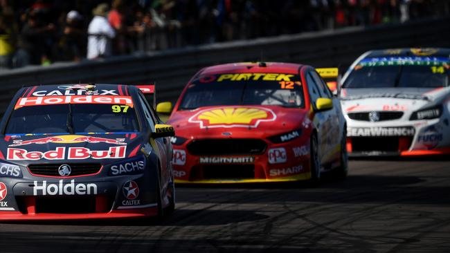 Red Bull Holden driver Shane van Gisbergen in his Holden Commodore VF leads the pack with Shell V-Power driver Fabian Coulthard in his Ford Falcon FG/X and Freighliner driver Tim Slade in his Holden Commodore VF close behind during Sunday's race 12 Virgin Australia V8 Supercars Championship, on the final day of this weekend's Triple Crown V8 Supercars event at the Hidden Valley Speedway in Darwin. Picture: Justin Kennedy