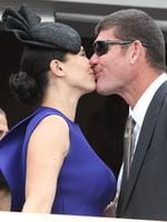 James and Erica Packer enjoy a kiss.