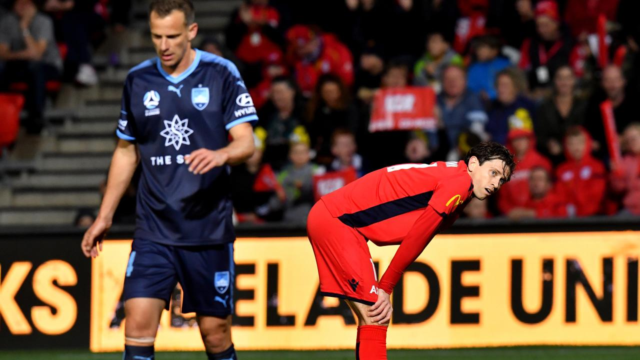 Craig Goodwin of United (right) reacts after missing a shot on goal