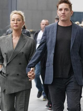Asher Keddie and her husband Vincent Fantauzzo arrive at Rod Laver Arena for the State Memorial service for music industry icon Michael Gudinski. Picture: David Geraghty