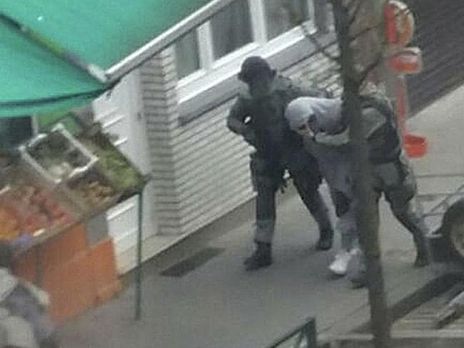 Salah Abdeslam is detained by police during a raid in the Molenbeek neighbourhood of Brussels, Belgium earlier this month.