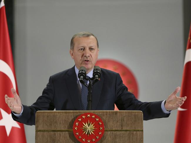 Critics say Turkey's President Tayyip Erdogan and the Islamist-rooted AK Party are undermining modern Turkey's secular foundations. Picture: Presidency Press Service via AP, Pool